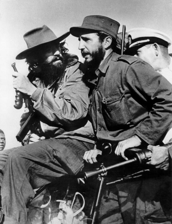 Cuban rebel leaders Fidel Castro (R) and Camilo Cienfuegos (L) enter Havana after the victory over the forces of Cuban dictator Fulgencio Batista on January 8, 1959. (AFP PHOTO/PRENSA LATINA)