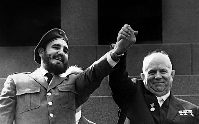 This May 1963 photo shows Cuban President Fidel Castro (L) clasping hands with Soviet leader Nikita Khrushchev during a four-week official visit to Moscow. (AFP PHOTO/TASS)