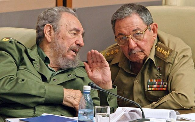 Then-Cuban President Fidel Castro (L) and his brother Raul, Minister of the Revolutionary Armed Forces, chat in Havana, during the last meeting of the Cuban Parliament on December 23, 2003. (AFP PHOTO/ADALBERTO ROQUE)