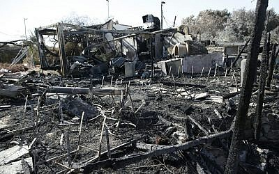 A picture shows the remains of the popular Nataf restaurant Rama's Kitchen on November 26, 2016, a day after it was burned down in a forest fire. (AFP PHOTO/AHMAD GHARABLI)