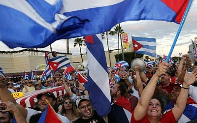 Cuban Americans celebrate the death of Cuban leader Fidel Castro in the streets of the Little Havana neighborhood of Miami, Florida on November 26, 2016. (Rhona Wise/AFP)