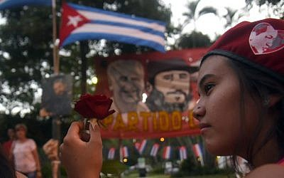 Supporters of Paraguay's Communist Party gather in Asuncion to pay tribute to deceased Cuban leader Fidel Castro on November 26, 2016. (Norberto Duarte/AFP)