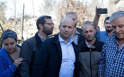 Naftali Bennett, center, in the Halamish settlement on November 27, 2016. (AFP/MENAHEM KAHANA)