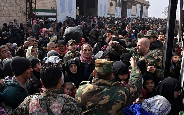 Syrian families, fleeing from various eastern districts of Aleppo, get onto a governmental bus on November 29, 2016 in the government-held eastern neighborhood of Jabal Badro, before heading to government-controlled western Aleppo, as the Syrian government offensive to recapture rebel-held Aleppo has prompted an exodus of civilians.  (AFP PHOTO: George OURFALIAN)