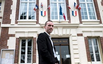 (FILES) This file photo taken on March 31, 2014 shows Cyril Nauth, newly elected mayor of Mantes-la-Ville for the French far-right Front National (FN) party, posing in front of the city hall of Mantes-la-Ville, some 50km west of Paris. (AFP PHOTO / FRED DUFOUR)