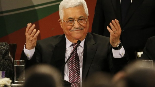 Palestinian Authority President Mahmoud Abbas gestures after delivering a speech, on the second day of the 7th Fatah Congress in the West Bank city of Ramallah, on November 30, 2016. (AFP/Abbas Momani)