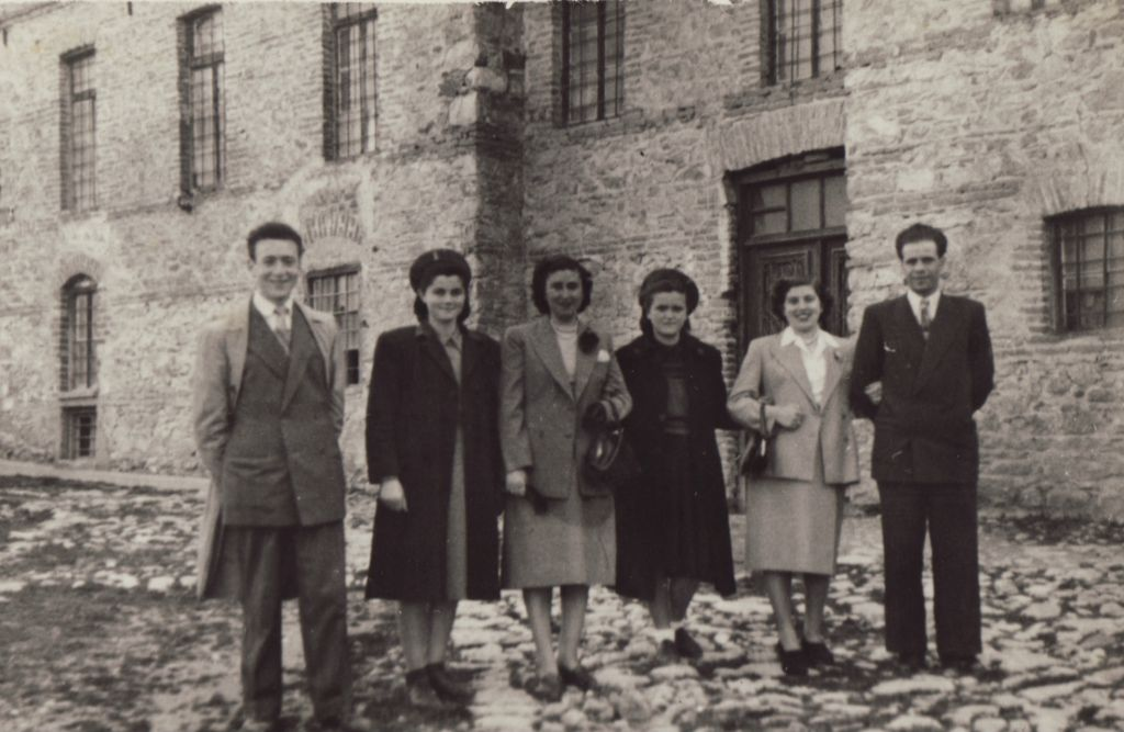 Beni Elias (far left), one of the film's main storytellers, in front of the mill in Kastoria circa 1951. The photo was taken when he tried his luck once more in Kastoria after the war. (Screenshot)