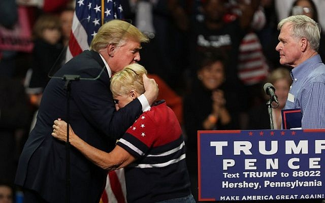 Donald Trump hugs a supporter, whose son was a passionate supporter of the GOP nominee and who was killed in a recent car crash, at a rally in Hershey, Pennsylvania on November 4, 2016. (Spencer Platt/Getty Images/AFP)