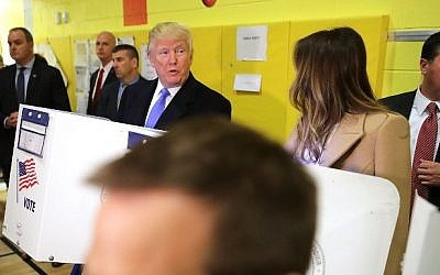 Surrounded by U.S. Secret Service agents, Republican presidential nominee Donald Trump and his wife Melania Trump cast their votes on Election Day at PS 59 November 8, 2016 in New York City. (Chip Somodevilla/Getty Images/AFP)