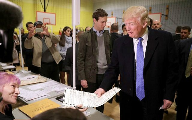 Republican presidential nominee Donald Trump collects his ballot with his son-in-law Jared Kushner on Election Day at a New York public school, November 8, 2016 in New York City. (Chip Somodevilla/Getty Images/AFP)