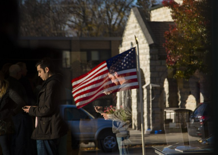 Voters go to the polls to cast their vote in the presidential election between Hillary Clinton and Donald Trump at the Cedarburg Community Center, November, 8, 2016 in Milwaukee, Wisconsin. (Darren Hauck/Getty Images/AFP)