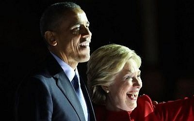 Democratic presidential nominee former Secretary of State Hillary Clinton stands with Barack Obama at an election eve rally on November 7, 2016 in Philadelphia, Pennsylvania. (Spencer Platt/Getty Images/AFP)
