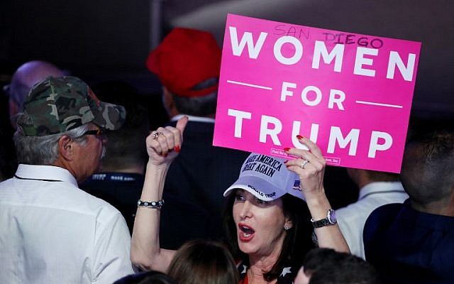 "An attendee holds up a sign in support of Republican presidential nominee Donald Trump that reads ""Women For Trump"" during the election night event at the New York Hilton Midtown on November 8, 2016 in New York City.  (Mark Wilson/Getty Images/AFP)"
