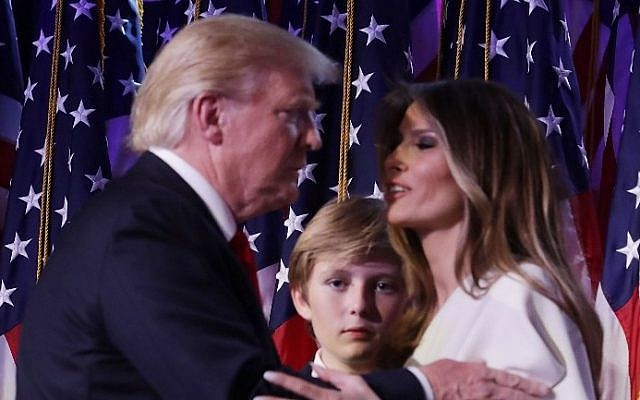 Republican president-elect Donald Trump embraces his wife Melania Trump, as their son Barron looks on, during his election night event at the New York Hilton Midtown in the early morning hours of November 9, 2016 in New York City. (Chip Somodevilla/Getty Images/AFP)