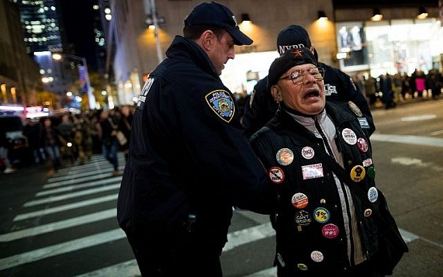 An anti-Donald Trump protester is arrested after marching in the street on Sixth Avenue, November 11, 2016 in New York City. The election of Trump as president has sparked protests in cities across the country.   (Drew Angerer/Getty Images/AFP)