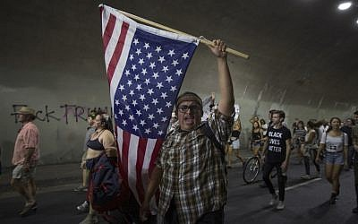 Anti-Trump protesters march on November 12, 2016 in Los Angeles, California, United States. (David McNew/Getty Images/AFP)