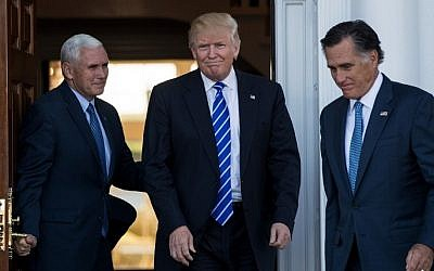 Vice president-elect Mike Pence, left, President-elect Donald Trump and Mitt Romney, right, leave the clubhouse after their meeting at Trump International Golf Club, Bedminster Township, New Jersey, November 19, 2016. (Drew Angerer/Getty Images/AFP)