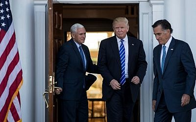 (L to R) Vice president-elect Mike Pence, President-elect Donald Trump and Mitt Romney leave the clubhouse after their meeting at Trump International Golf Club, November 19, 2016 in Bedminster Township, New Jersey.  (Drew Angerer/Getty Images/AFP)