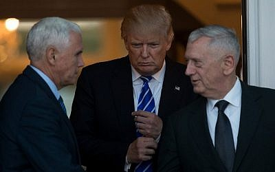 (L to R) Vice President-elect Mike Pence, President-elect Donald Trump, and retired United States Marine Corps general James Mattis exit the clubhouse after their meeting at Trump International Golf Club, November 19, 2016 in Bedminster Township, New Jersey. (Drew Angerer/Getty Images/AFP)