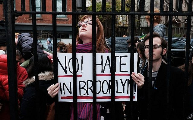 People participate in an anti-hate rally at a Brooklyn park named in memory of Beastie Boys band member Adam Yauch after it was defaced with swastikas on November 20, 2016 in New York City. (Spencer Platt/Getty Images/AFP)