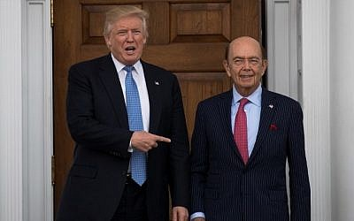 President-elect Donald Trump and investor Wilbur Ross pose for a photo following their meeting at Trump International Golf Club, November 20, 2016 in Bedminster Township, New Jersey. (Drew Angerer/Getty Images/AFP)