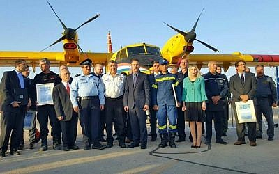 Minister of Public Security Gilad Erdan with representatives from the foreign firefighting teams at a ceremony to thank the firefighters for helping to extinguish the wave of fires that swept across. Israel. Tuesday, November 29, 2016. (Israel Police spokesman via Facebook)