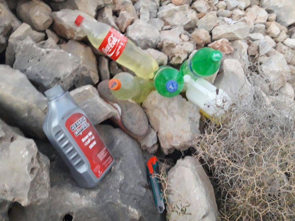 Bottles of gasoline found in a field outside the West Bank settlement of Ma'ale Shomron on November 25, 2016. (IDF Spokesperson's Unit)