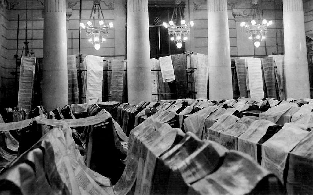 Torah scrolls unrolled to dry in the great synagogue of Rome. (Courtesy of Opera del Tempio)