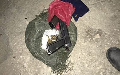 A pistol and ammunition found in an alleged gunsmithing workshop in the Palestinian village of Mirka, outside Jenin, on November 10, 2016. (IDF Spokesperson's Unit)