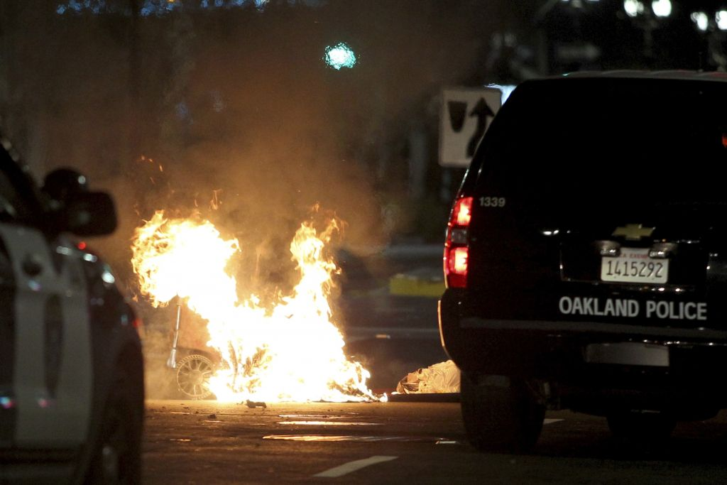A trash fire burns during protests in Oakland, Calif., late Tuesday, November 8, 2016. President-elect Donald Trump's victory set off multiple protests. (Anda Chu/Bay Area News Group via AP)