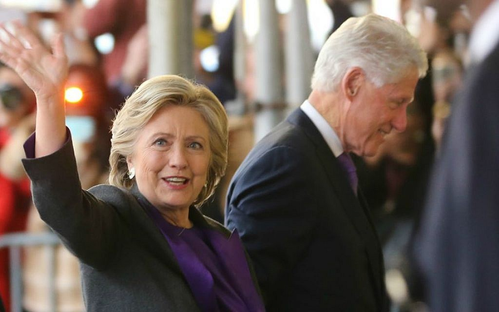 Hillary Clinton, holding hands with her husband, former President Bill Clinton, waves to a crowd outside a New York hotel as she arrives to speak to her staff and supporters after losing the race for the White House, Wednesday, Nov. 9, 2016. (AP Photo/Seth Wenig)