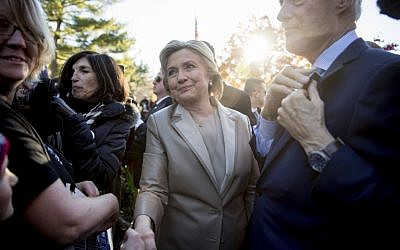 Hillary Clinton, accompanied by her husband, former President Bill Clinton, right, greets supporters outside Douglas G. Grafflin School in Chappaqua, NY, November 8, 2016, after voting. (AP/Andrew Harnik)