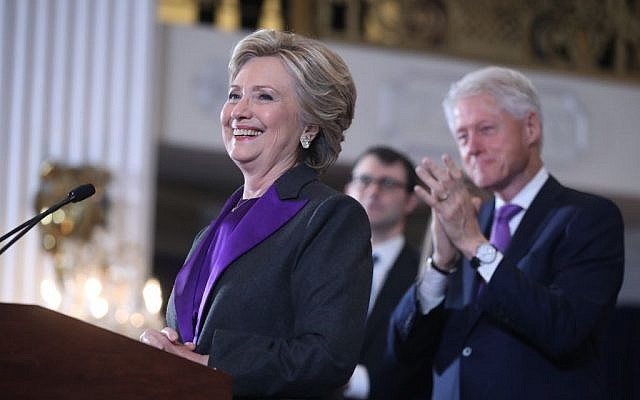 Former president Bill Clinton applauds as his wife, Democratic presidential candidate Hillary Clinton speaks in New York, Wednesday, Nov. 9, 2016. Clinton conceded the presidency to Donald Trump in a phone call early Wednesday morning.  (AP Photo/Andrew Harnik)