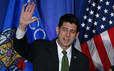 House Speaker Paul Ryan of Wisconsin waves to supporters at a campaign rally in Janesville, WI, on Tuesday, November 8, 2016. (AP Photo/Paul Sancya)