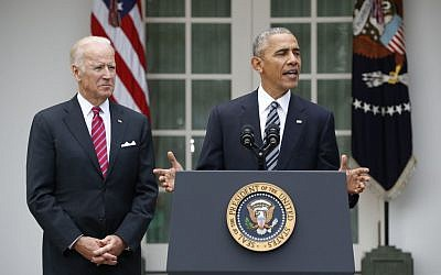 President Barack Obama, accompanied by Vice President Joe Biden, speaks Wednesday, Nov. 9, 2016, in the Rose Garden of the White House in Washington. (AP Photo/Pablo Martinez Monsivais)