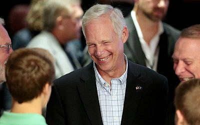 US Sen. Ron Johnson, R-Wisconsin, visits with supporters at his Election Night party at the Oshkosh Convention Center in Oshkosh, Wisconsin, November 8, 2016. (Michael P. King/Wisconsin State Journal via AP)