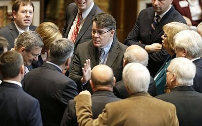 In this May 2, 2014 photo, Iowa Senate Majority Leader Michael Gronstal, center, talks to fellow Senate Democrats on the floor of the Senate at the Statehouse in Des Moines, Iowa. (AP Photo/Charlie Neibergall, File)