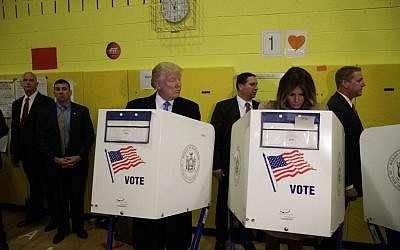 Republican presidential candidate Donald Trump looks at his wife Melania as they cast their votes aat PS-59 in New York, November 8, 2016. (AP Photo/ Evan Vucci)