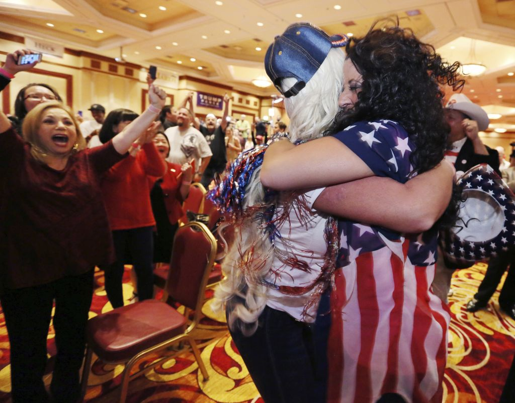 Diana Caldon, right, embraces Stephanie Smith in celebration at an election night watch party hosted by the Nevada GOP as Donald Trump wins the presidency Tuesday, November 8, 2016, in Las Vegas. (AP Photo/Ronda Churchill)