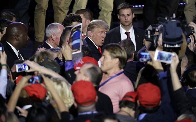 President-elect Donald Trump shakes hands with supporters after giving his acceptance speech during his election night rally, Wednesday, November 9, 2016, in New York. (AP Photo/John Locher)