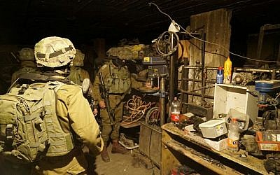 Israeli soldiers seize a drill press from a workshop allegedly used to manufacture illegal guns in the West Bank city of Jenin, early in the morning on November 8, 2016. (IDF Spokesperson's Unit)