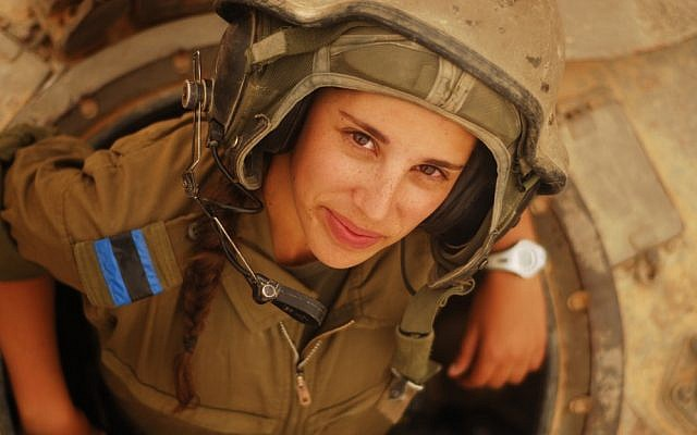Illustrative. A female tank instructor peeks out of her vehicle during an exercise on May 4, 2012. (Israel Defense Forces/Flickr)