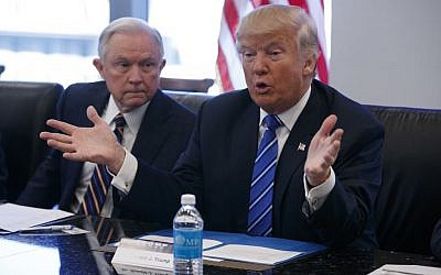 Alabama Sen. Jeff Sessions, left, looks on as Republican presidential candidate Donald Trump speaks during a national security meeting with advisors at Trump Tower, Friday, Oct. 7, 2016 (Evan Vucci/AP)