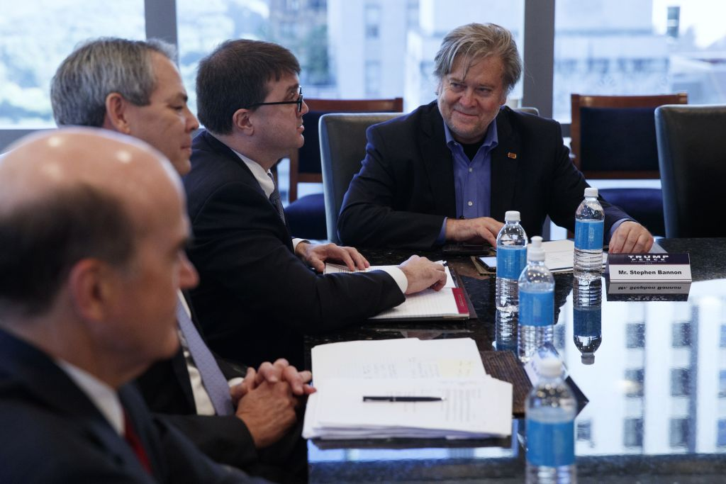 Steve Bannon, right, looks on during a national security meeting with advisors at Trump Tower, Friday, October 7, 2016 (AP Photo/ Evan Vucci)
