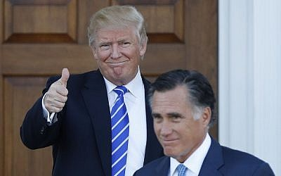 President-elect Donald Trump gives the thumbs-up as Mitt Romney leaves Trump National Golf Club Bedminster in Bedminster, N.J., November 19, 2016. (AP Photo/Carolyn Kaster)