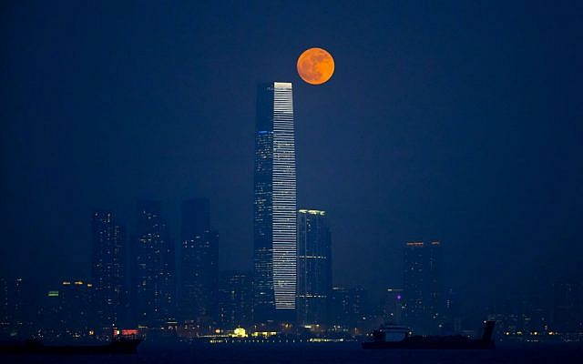 The brightest moon in almost 69 years rises over Victoria Harbour in Hong Kong, Monday, Nov. 14, 2016. The phenomenon is known as the supermoon. The tall building is the International Commerce Centre. (Kin Cheung/AP Photo)