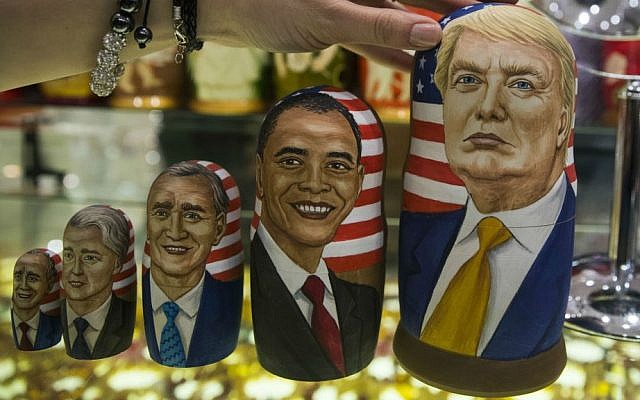Traditional Russian wooden dolls called Matreska depict US presidents, from left, George H.W. Bush, Bill Clinton, George W. Bush, Barack Obama and US president-elect Donald Trump displayed in a shop in Moscow, Russia on Tuesday, Nov. 8, 2016. (AP Photo/Pavel Golovkin)