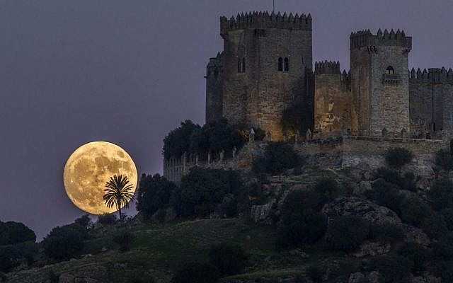 The moon rises behind the castle of Almodovar in Cordoba, southern Spain, on Sunday, Nov. 13, 2016. The supermoon on November 14, 2016, is the closest a full moon has been to Earth since January 26, 1948. (Miguel Morenatti/AP Photo)