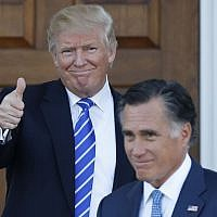 President-elect Donald Trump gives the thumbs-up as Mitt Romney leaves Trump National Golf Club Bedminster in Bedminster, N.J., Saturday, Nov. 19, 2016. (AP Photo/Carolyn Kaster)
