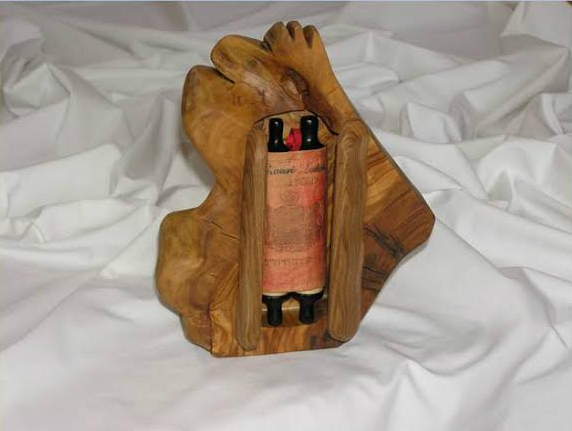 Henry Fenichel's Torah in an olive wood case carved by Rafael Ben Zeev. (Courtesy Fenichel)